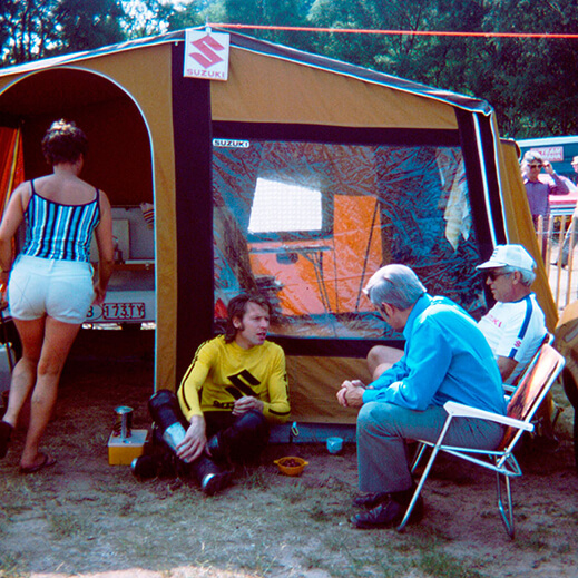 Roger De Coster talking with fans at a campsite